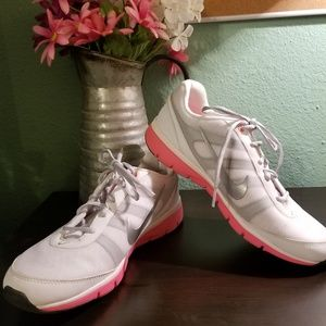 Pink white and grey Nike shoes